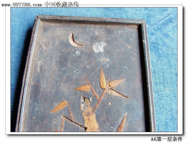 木板底上面有骨头做的竹子图案