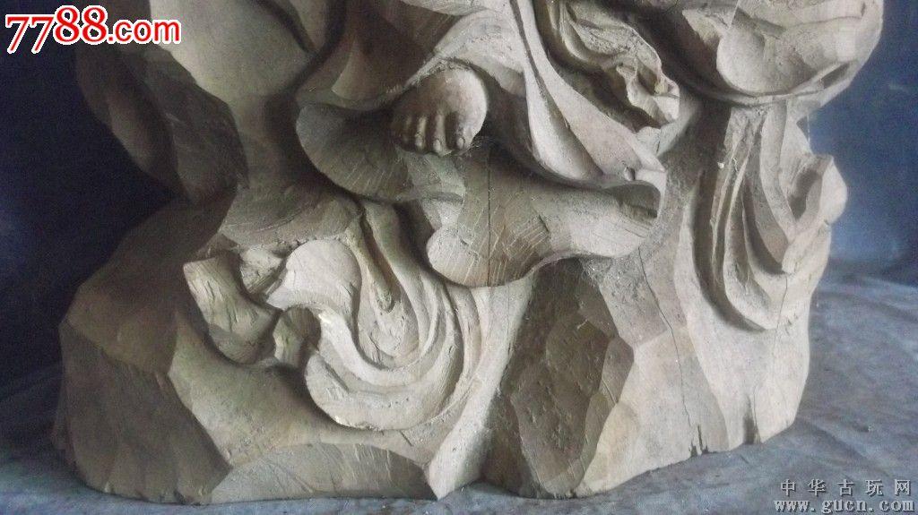 木雕持卷观音像,红豆杉雕刻的,非常好